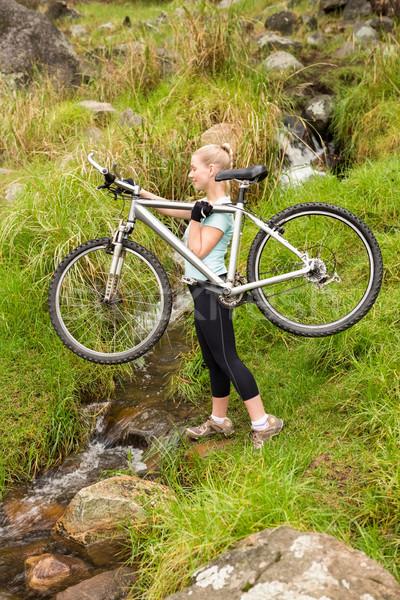 Mosolyog fitt nő emel bicikli boldog Stock fotó © wavebreak_media
