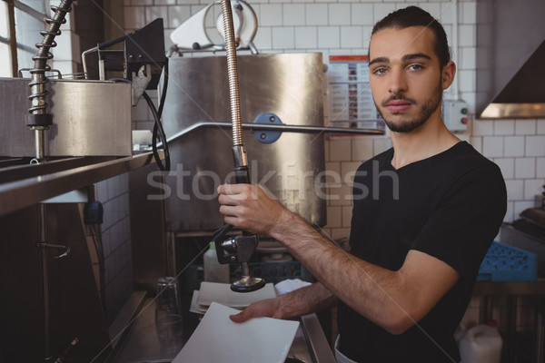 Portrait of waiter washing plate in kitchen Stock photo © wavebreak_media
