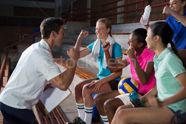 Volleyball coach talking to female players Stock photo © wavebreak_media