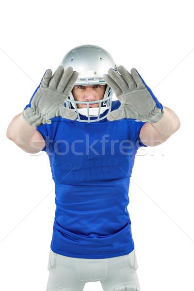 Confident American football player defending Stock photo © wavebreak_media