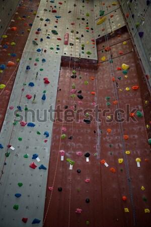 Athletes practicing rock climbing in health club Stock photo © wavebreak_media