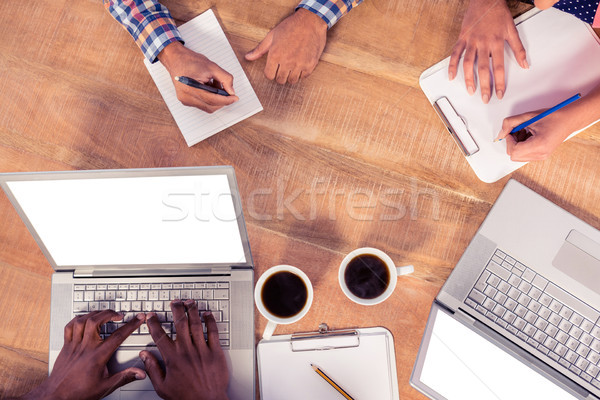 High angle view of business people working Stock photo © wavebreak_media