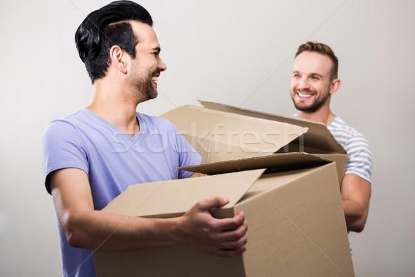 Felice gay Coppia scatole nuova casa Foto d'archivio © wavebreak_media