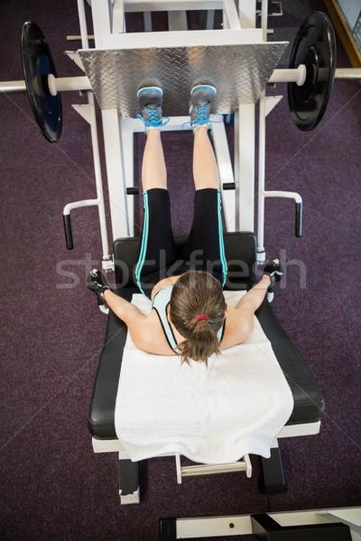 Fit brunette doing exercises for legs Stock photo © wavebreak_media