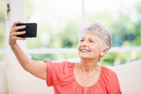 Mutlu kıdemli kadın ev pencere Stok fotoğraf © wavebreak_media