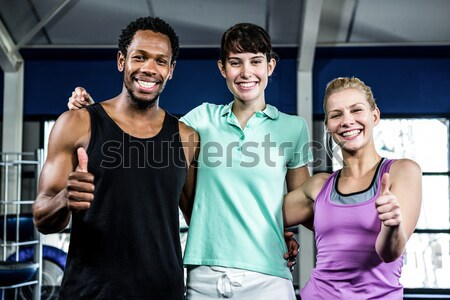 Stock photo: Athletic men and women posing