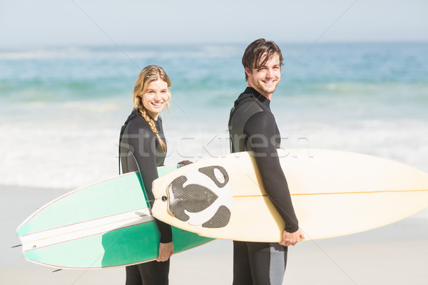 Pareja tabla de surf pie playa mujer Foto stock © wavebreak_media