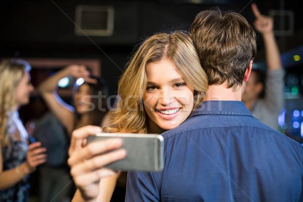 Vrouw smartphone vriendje discotheek telefoon Stockfoto © wavebreak_media