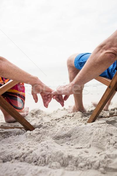 Boldog idős pár megnyugtató hátsó nézet ül kéz a kézben Stock fotó © wavebreak_media