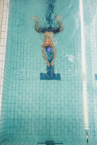 Swimmer doing the breaststroke in swimming pool Stock photo © wavebreak_media