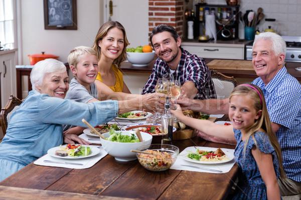 Multi-generation family toasting glass of wine while having meal Stock photo © wavebreak_media