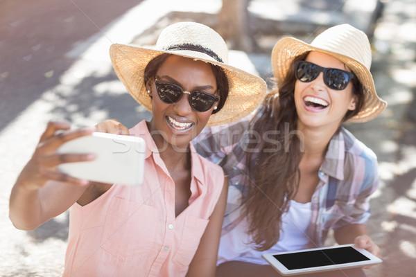 Friends taking selfie on mobile phone Stock photo © wavebreak_media