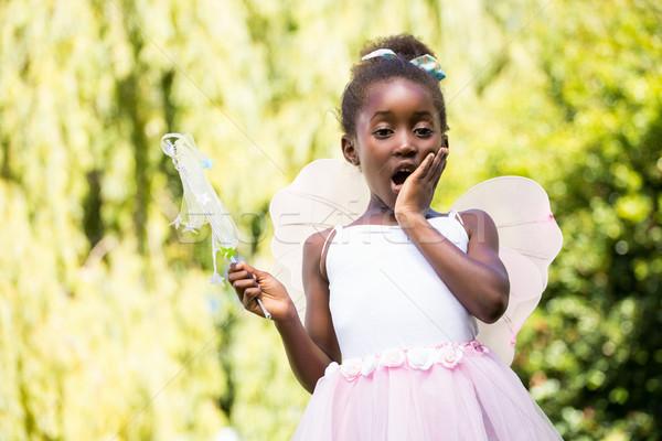 Cute mixed-race girl wearing a fairy dress Stock photo © wavebreak_media