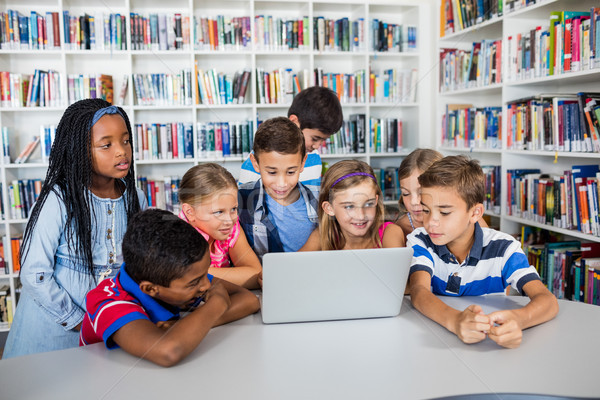 Front view of pupils studying with laptop Stock photo © wavebreak_media