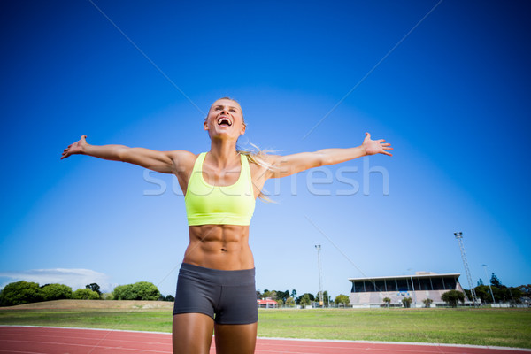 Excited female athlete posing after a victory Stock photo © wavebreak_media