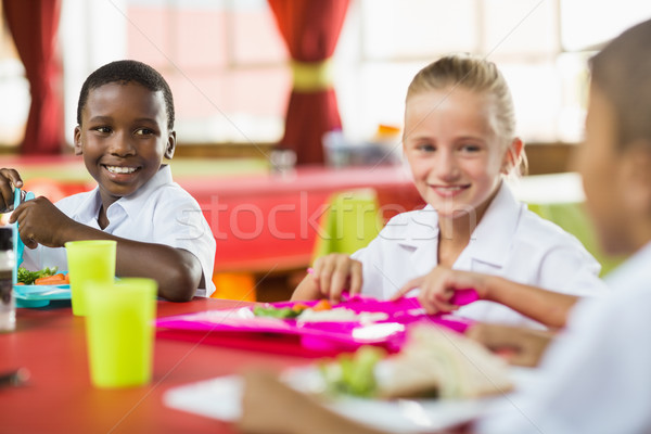 Children having lunch during break time in school cafeteria Stock photo © wavebreak_media