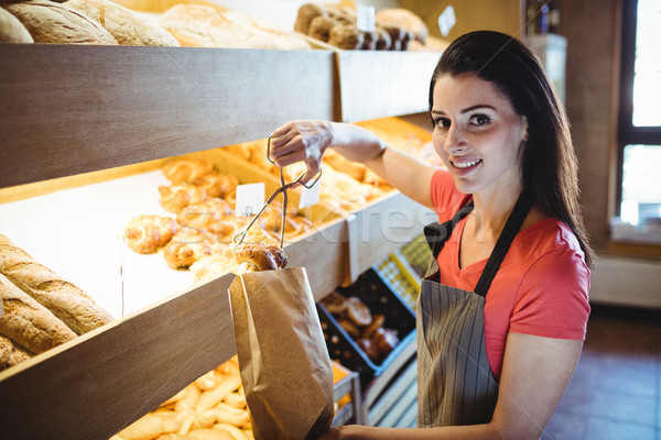Female baker packing sweet food Stock photo © wavebreak_media