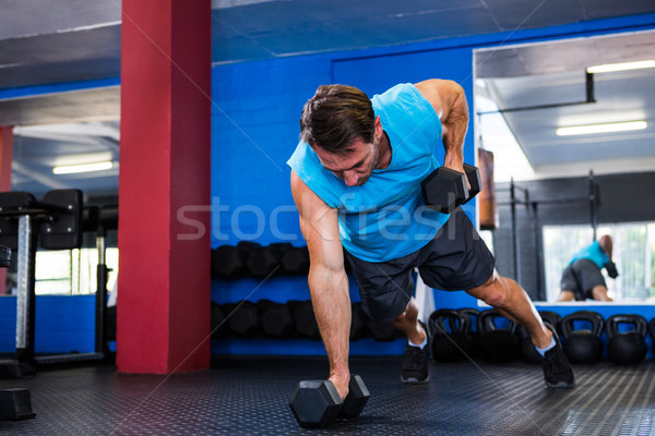 Young athlete lifting dumbbells in gym Stock photo © wavebreak_media