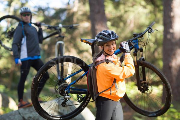 Coppia mountain bike piedi foresta Foto d'archivio © wavebreak_media