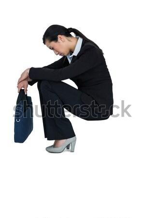 Deprimido mujer de negocios sesión bolso blanco triste Foto stock © wavebreak_media