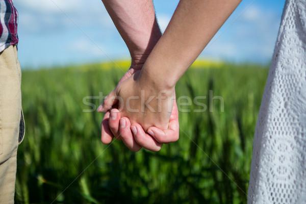 Középső rész pár kéz a kézben mező napos idő nő Stock fotó © wavebreak_media