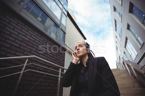 Businesswoman talking on mobile phone Stock photo © wavebreak_media