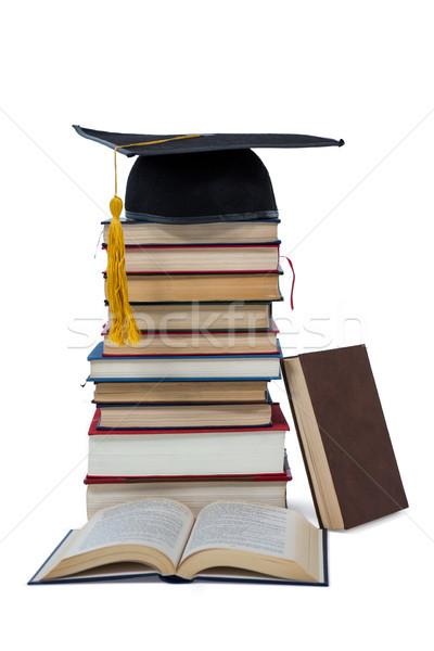 Mortarboard on stack of books Stock photo © wavebreak_media