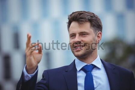 улыбаясь бизнесмен говорить мобильного телефона служба коридор Сток-фото © wavebreak_media