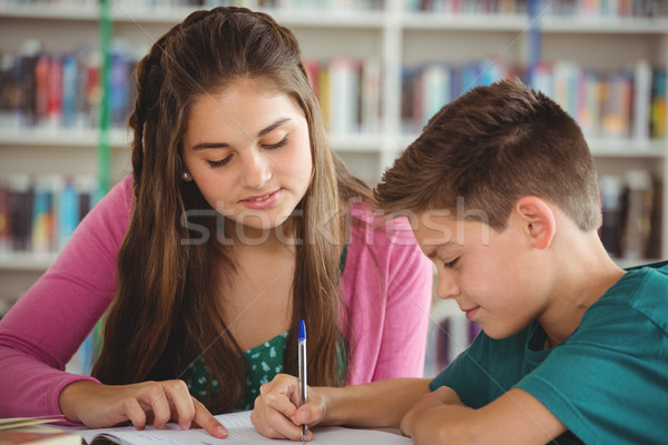 School kids doing homework in library at school Stock photo © wavebreak_media