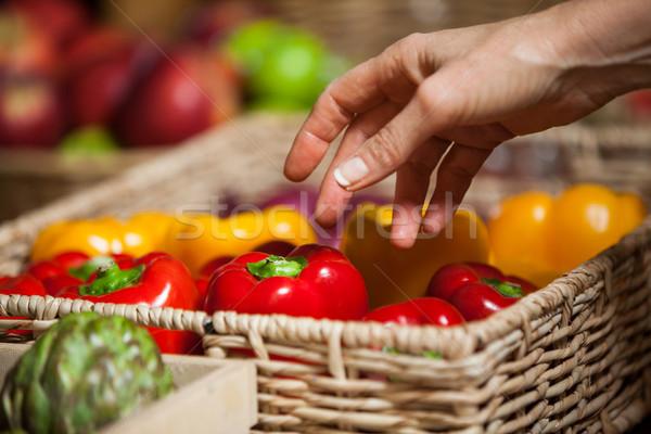 Hand of female costumer holding bell pepper in organic section Stock photo © wavebreak_media
