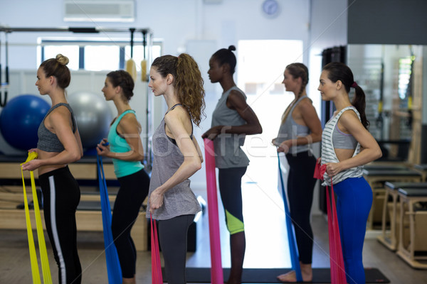 Fit women performing stretching exercise with resistance band Stock photo © wavebreak_media