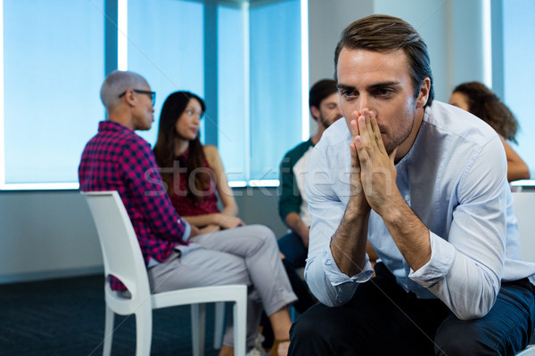 Man crying while creative business team in background Stock photo © wavebreak_media