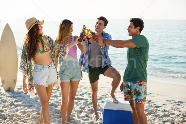 Friends toasting on shore at beach Stock photo © wavebreak_media