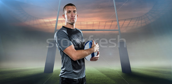 Composite image of confident rugby player in holding ball Stock photo © wavebreak_media