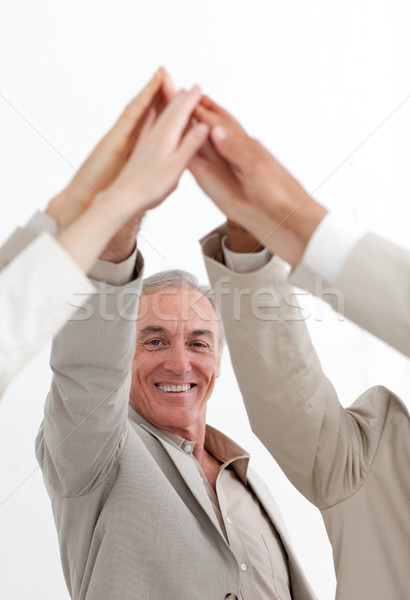 Smiling businessman joining hands with his team Stock photo © wavebreak_media