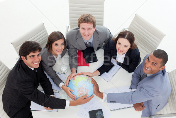 High angle of a diverse business team holding a terrestrial glob Stock photo © wavebreak_media
