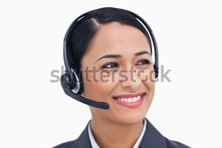 харизматический деловая женщина гарнитура столе служба бизнеса Сток-фото © wavebreak_media