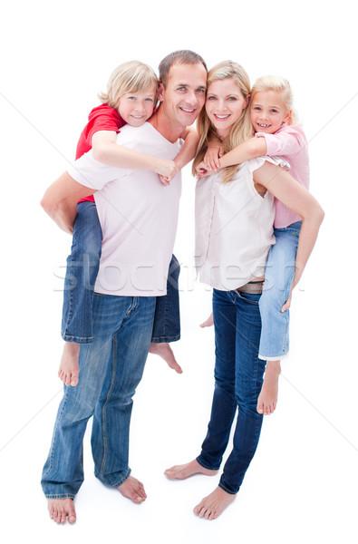 Atento pais crianças piggyback família sorrir Foto stock © wavebreak_media