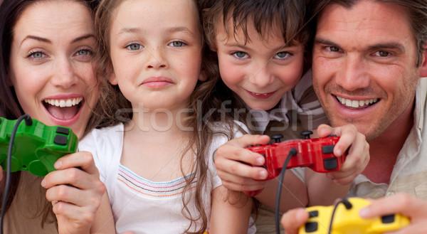 Eccitato famiglia giocare videogiochi uomo bambino Foto d'archivio © wavebreak_media