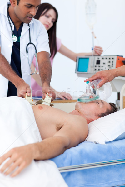 Serious medical team resuscitating a patient Stock photo © wavebreak_media