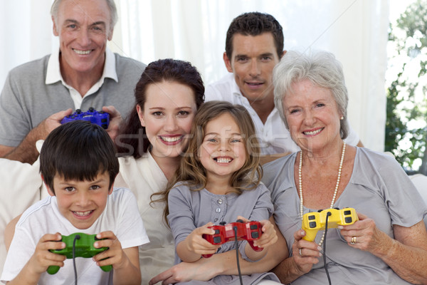 Grandparents, parents and children playing video games Stock photo © wavebreak_media