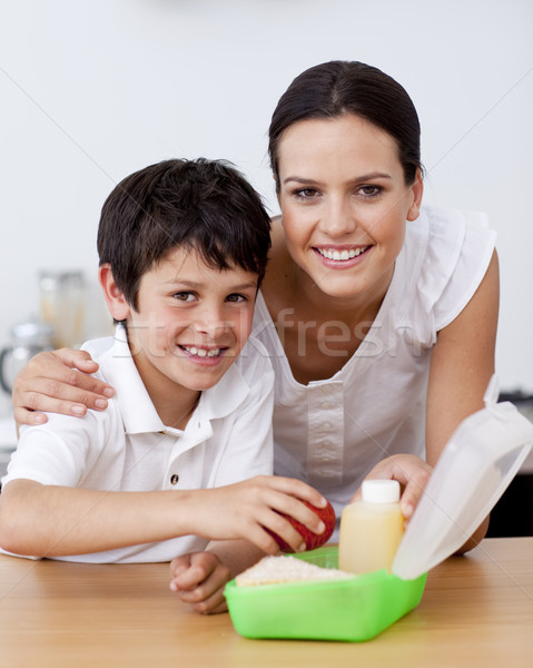 Smiling mother and son making the school lunch Stock photo © wavebreak_media
