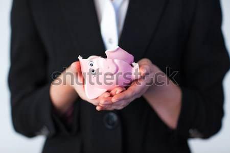 Mulher de negócios quebrado piggy bank jovem dinheiro Foto stock © wavebreak_media