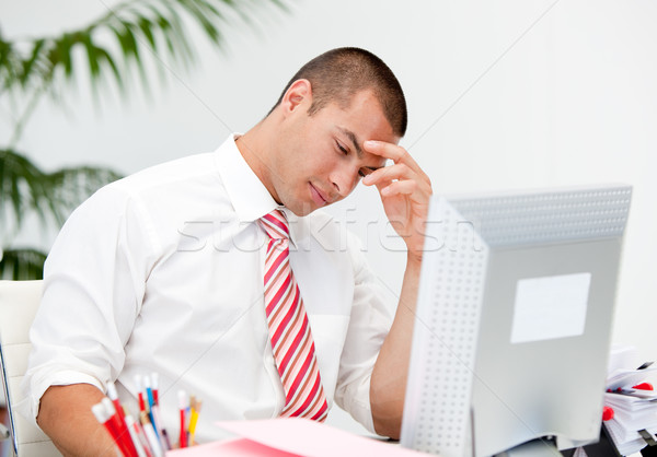 Stressed businessman working at a computer  Stock photo © wavebreak_media
