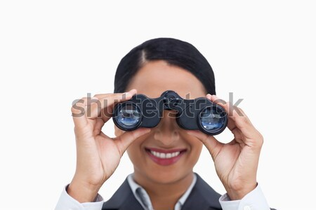 Visionary businesswoman looking through binoculars  Stock photo © wavebreak_media