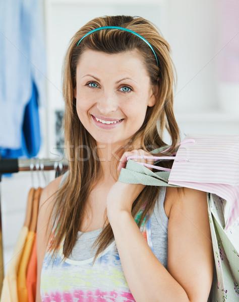 Happy woman choosing clothes in a shop  Stock photo © wavebreak_media