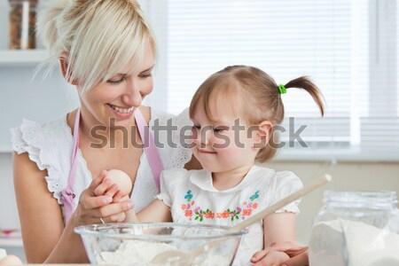 Sweet woman baking cookies with her daughter in kitchen Stock photo © wavebreak_media
