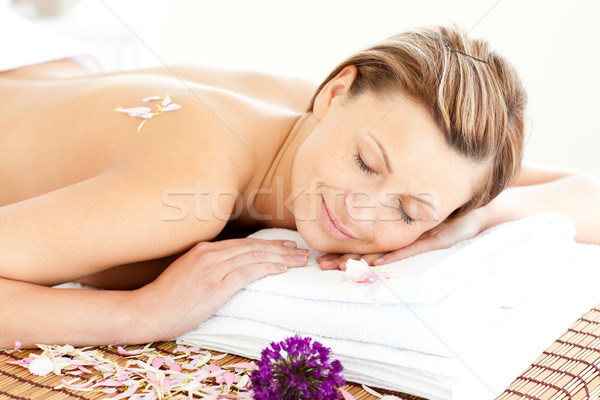 Beautiful relaxed woman lying on a massage table in  spa center Stock photo © wavebreak_media