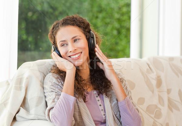 Radiant woman listening to music Stock photo © wavebreak_media