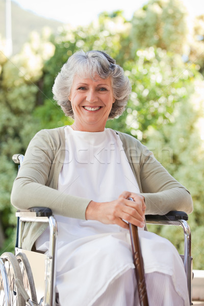 Elderly woman with her walking stick at home Stock photo © wavebreak_media
